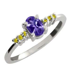 0.49 Ct Oval Blue Tanzanite and Canary Diamond 10k White