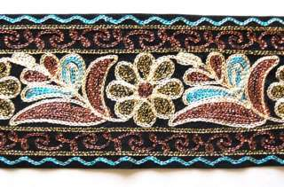 wide, black velvet ribbon with a floral design embroidered in blue