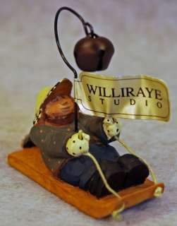 BOY ON SLED WITH BELL TREE ORNAMENT WW2617   GREEN COAT