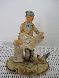 PORTUGESE POTTERY FIGURINE OLD MAN READING A NEWSPAPER