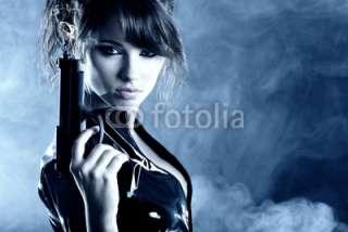 Photo beautiful sexy girl holding gun . smoke background © T.Tulic